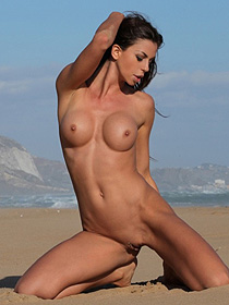 Busty Laura Is Naked At The Beach
